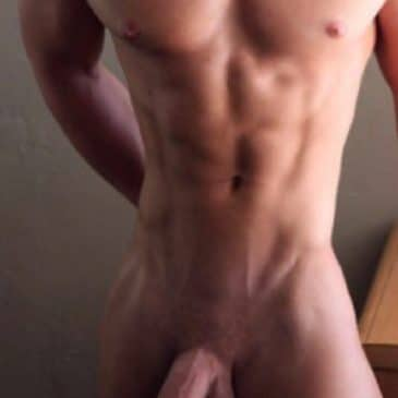 naked muscular man with head down